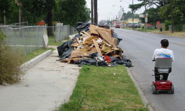 Debris blocking sidewalk.